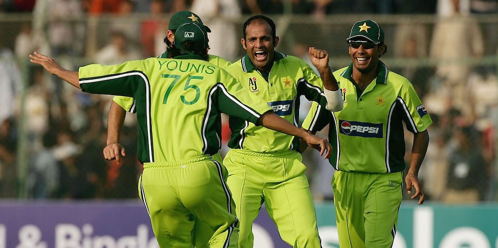 KARACHI, PAKISTAN - DECEMBER 15: Rana Naved-ul-Hasan of Pakistan celebrates with with Mohammad Sami after taking the wicket of Vikram Solanki of England during the 3rd One Day International between Pakistan and England played at The National Stadium on December 15, 2005 in Karachi, Pakistan. (Photo by Paul Gilham/Getty Images) *** Local Caption *** Rana Naved-ul-Hasan;Mohammad Sami