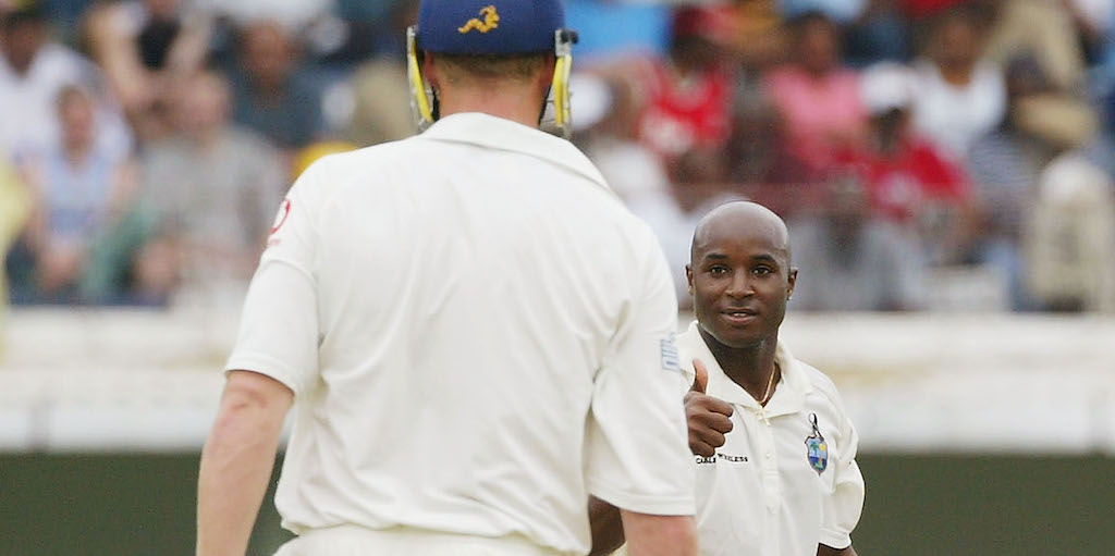KINGSTON, JAMAICA - MARCH 13: Tino Best of the West Indies gives the thumbs up to Andrew Flintoff of England during Day 3 of the 1st Test between West Indies and England at Sabina Park, on March 13, 2004, in Kingston, Jamaica. (Photo by Tom Shaw/Getty Images) *** Local Caption *** Tino Best;Andrew Flintoff