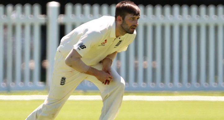 Mark Wood holding himself