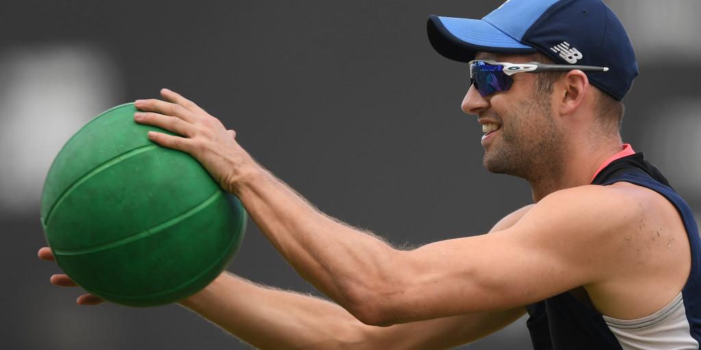 Mark Wood holding a big green ball