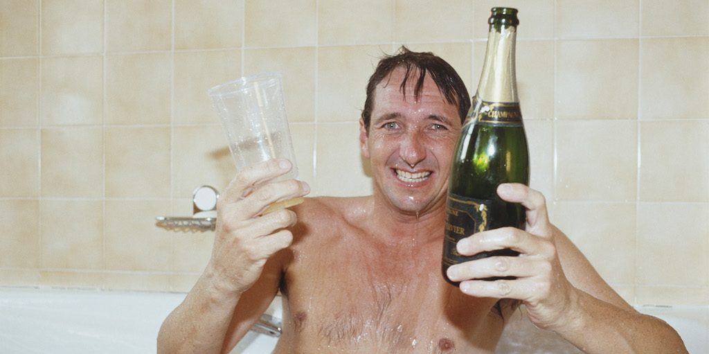 NOTTINGHAM, UNITED KINGDOM - AUGUST 25: Nottinghamshire batsman Derek Randall celebrates in the bath with champagne after Notts had beaten to Derbyshire to win the 1991 Refuge Assurance Sunday League Title at Trent Bridge on August 25, 1991 in Nottingham, England (Photo by Gary M Prior/Allsport/Getty Images)