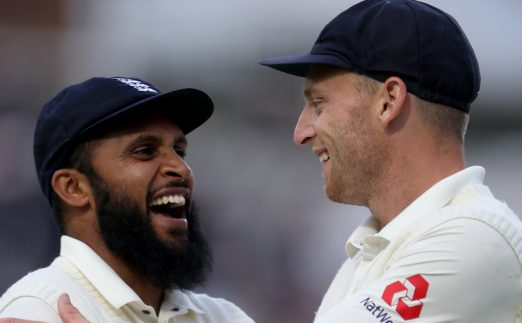 England's Adil Rashid and Jos Buttler (right) after the end of play during the test match at The Kia Oval, London.