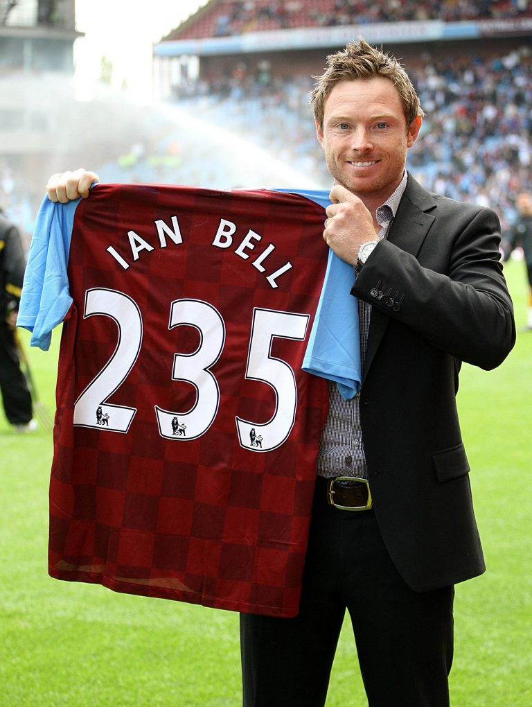 Ian Bell, an Aston Villa fan, holds up a club shirt signifying his 235 runs against India