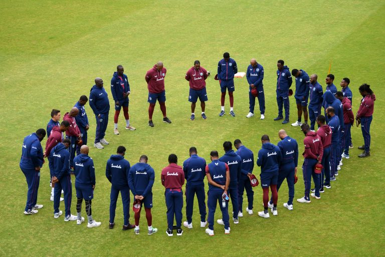 The West Indies team observe a moment of silence
