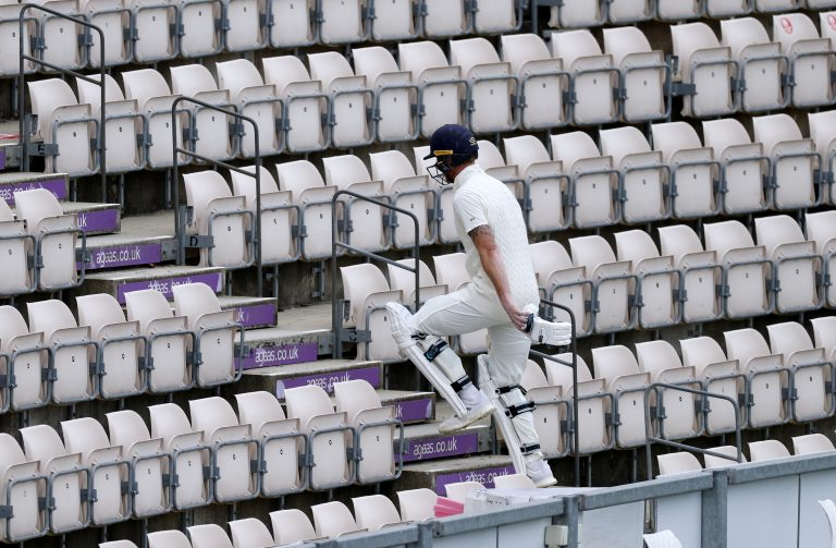 Stokes leaves the pitch after having his wicket taken by Holder