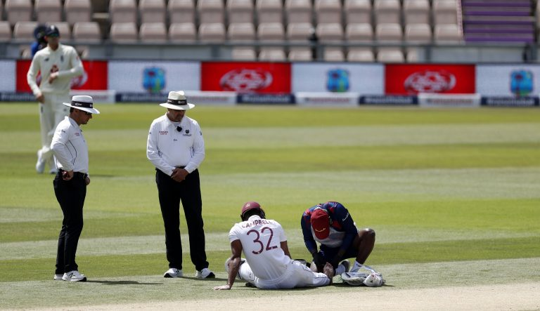 West Indies' John Campbell receives medical treatment prior to retiring injured