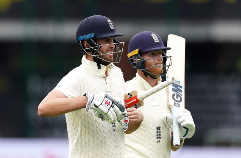 England's Dom Sibley and Ben Stokes walk off for tea