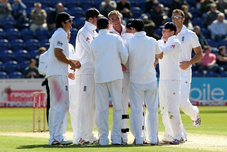 Stuart Broad (centre) is congratulated after dismissing Sri Lanka's Thisara Perera for his 100th wicket in Test cricket in 2011