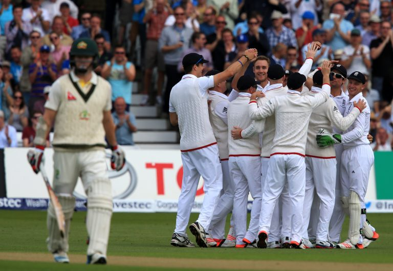 England bowler Stuart Broad is mobbed after he claimed his 300th Test wicket after Australia opener Chris Rodgers were dismissed for a duck in the 2015 Ashes series