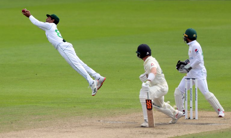 Dom Bess falls to a brilliant catch by Asad Shafiq, left