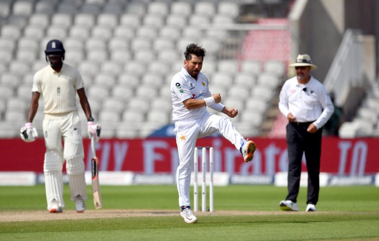 Yasir Shah celebrates taking the wicket of England's Chris Woakes