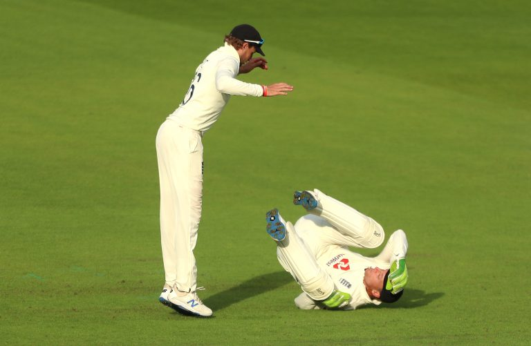 Jos Buttler, right, and Joe Root react to a missed chance