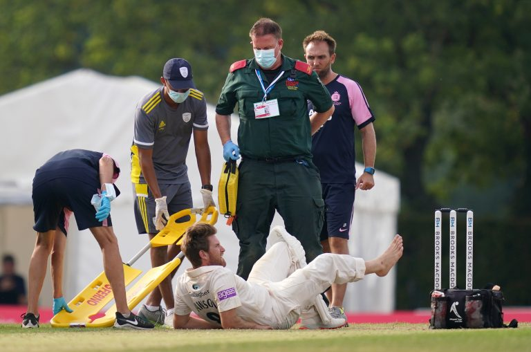 Liam Dawson had to be carried off on a stretcher with what looked a serious Achilles tendon injury.