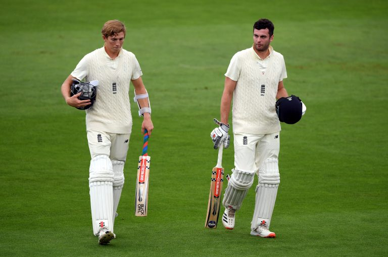 England's Zak Crawley and Dom Sibley walk off the pitch due to bad light and rain
