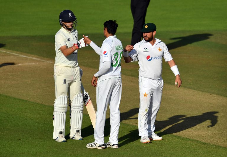England's Joe Root and Pakistan's Mohammad Abbas fist bump after the second Test ends in a draw