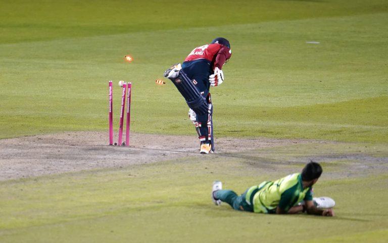 Chris Jordan (left) is run out by Pakistan's Wahab Riaz