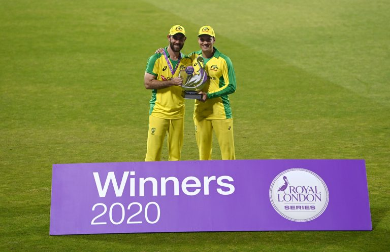 Glenn Maxwell, left, and Alex Carey pose with the trophy