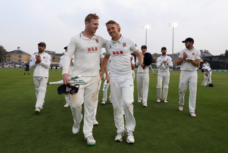 Jamie Porter (right) celebrates Essex's 2019 County Championship win.