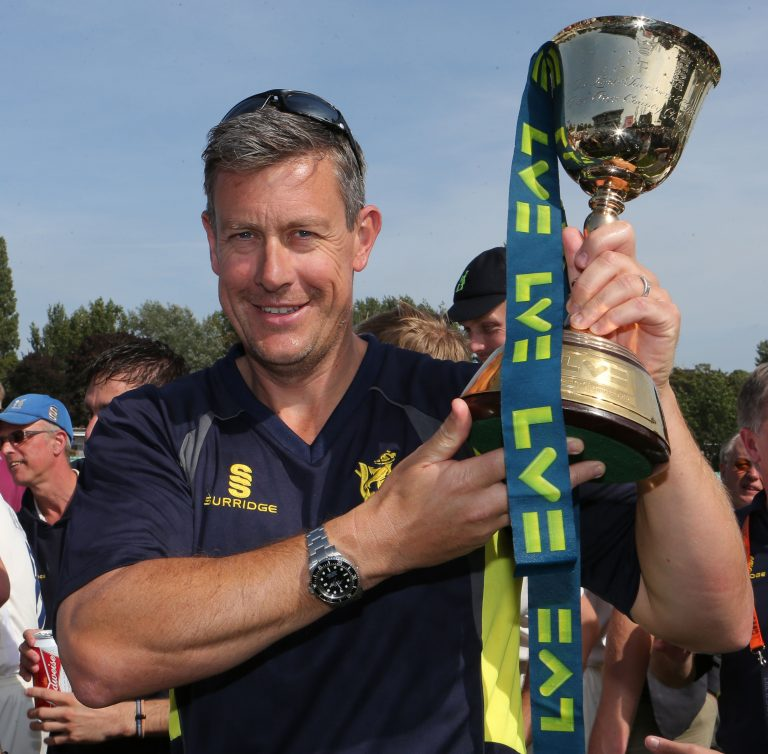 Then Warwickshire coach Ashley Giles celebrates with the County Championship trophy