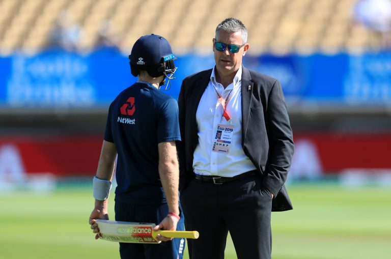 England's managing director of men's cricket Ashley Giles (right) speaks with Joe Root