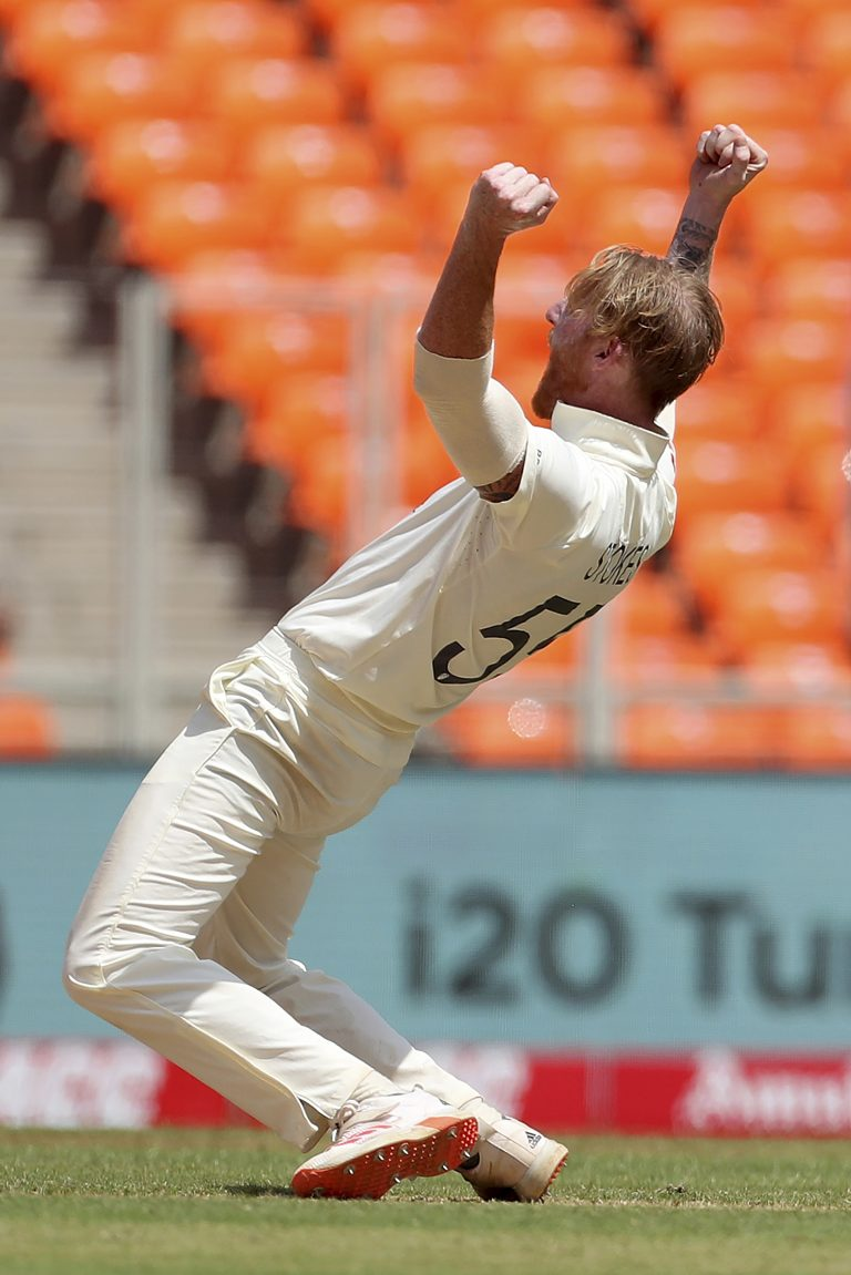Ben Stokes celebrates the dismissal of India's Rohit Sharma