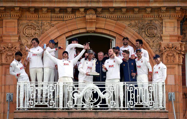 Feroze Khushi, far left, recoils after beer is poured on him during the trophy celebration