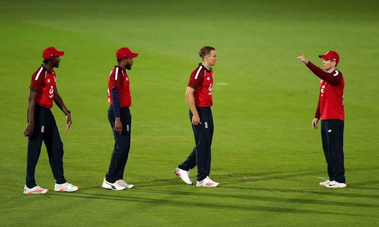 Eoin Morgan talks to his England team-mates