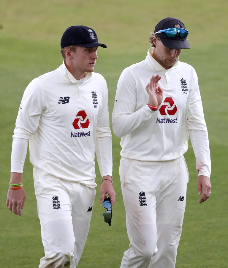Bess (left) has discussed his experience with Test captain Joe Root (right).