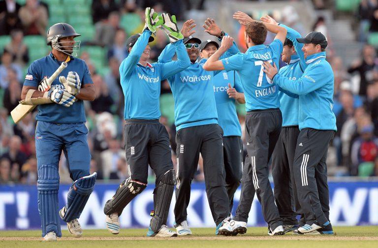 Gurney, third right, celebrates taking the wicket of Kumar Sangakkara for England