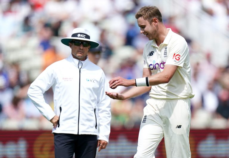 Stuart Broad (right) speaks to the umpires