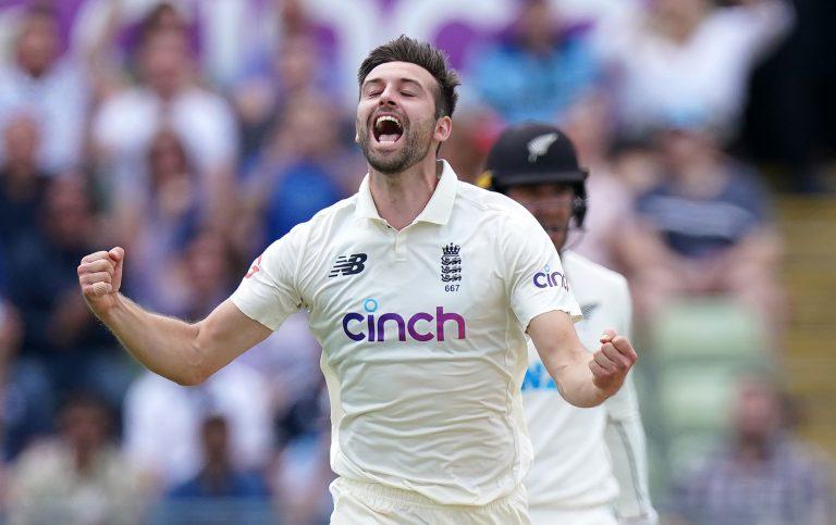Mark Wood celebrates taking the wicket of Henry Nicholls