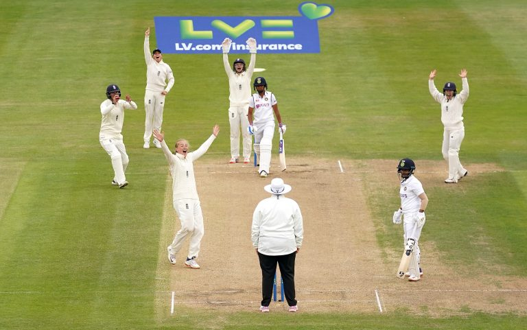 Sophie Ecclestone, centre left, appeals for the wicket of Harmanpreet Kaur