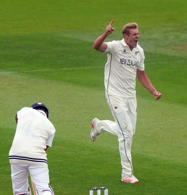 New Zealand's Kyle Jamieson celebrates the wicket of Rohit Sharma