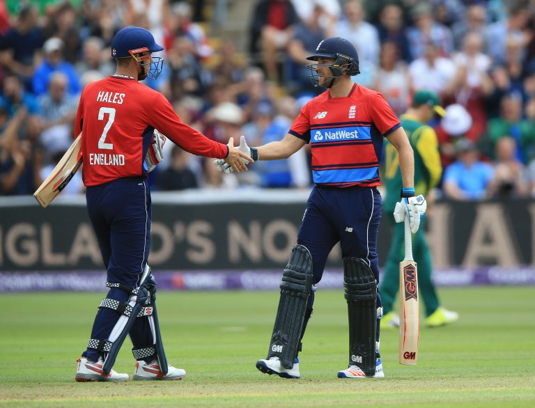 England's Dawid Malan, right, is congratulated by Alex Hales after reaching his half-century