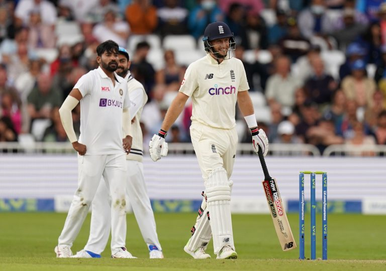 England's Joe Root smiles after India refer an lbw decision