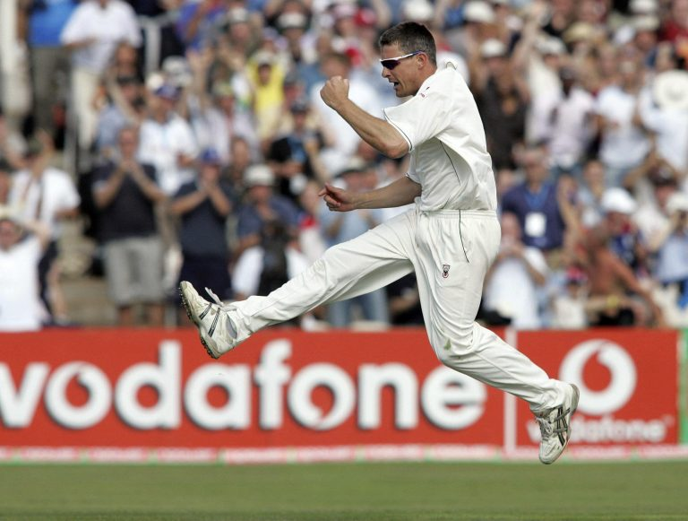 England's Ashley Giles celebrates after clean bowling Australia's Damien Martyn