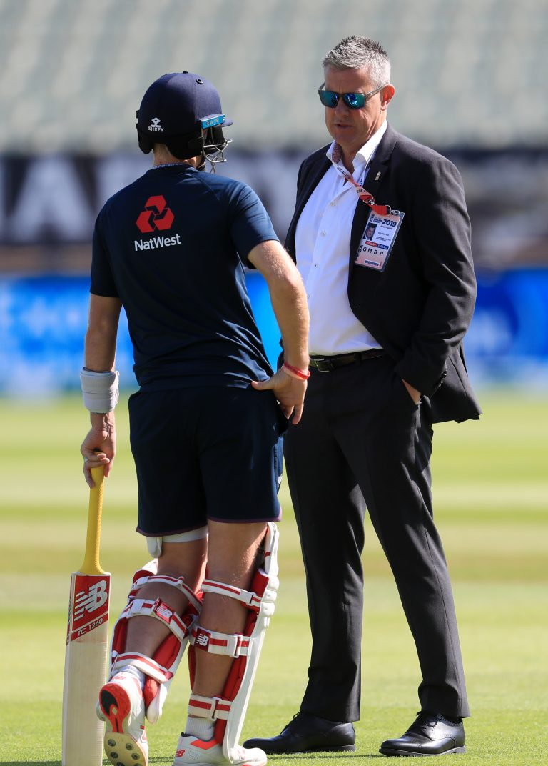 ECB Managing director Ashely Giles (right) speaks with England's Joe Root during day five of the Ashes Test match at Edgbaston