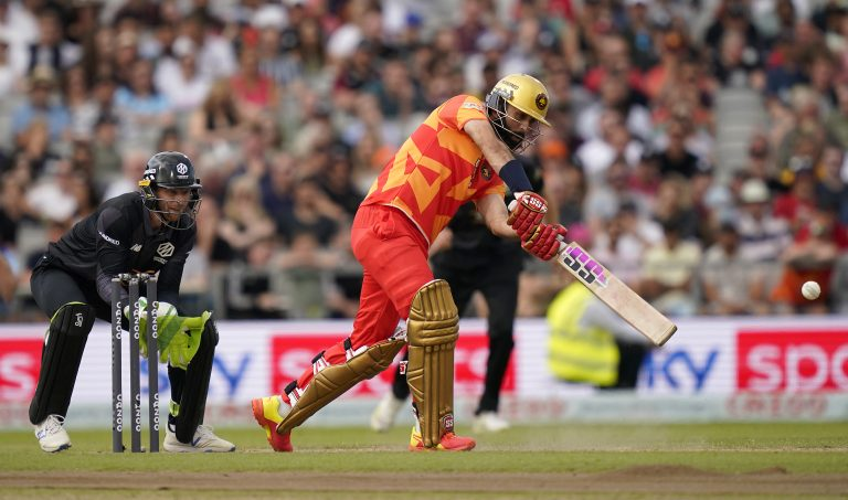 Moeen Ali, right, hits out against Manchester Originals in The Hundred