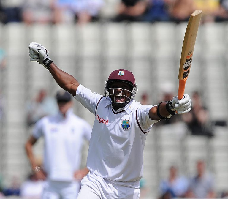 Tino Best celebrates after reaching his half-century against England (Nigel French/PA)