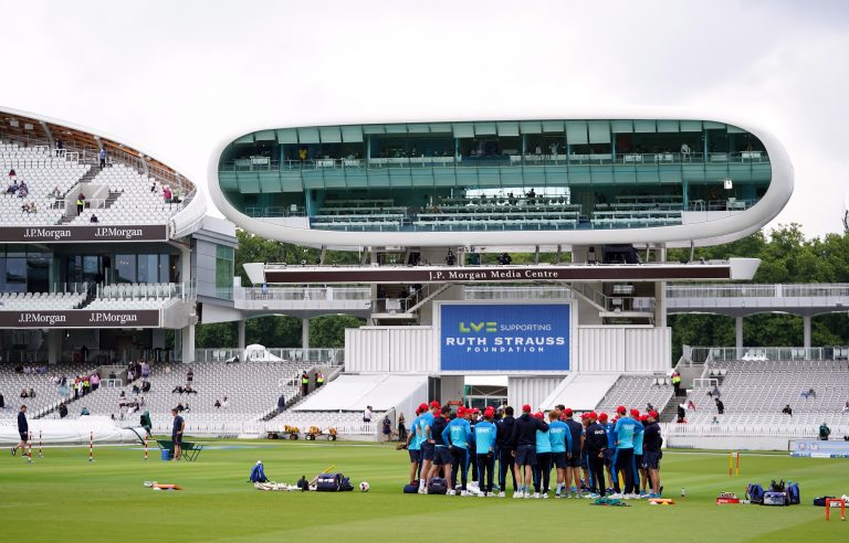 England players have a team huddle on the pitch at Lord's