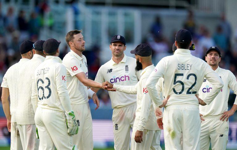 Ollie Robinson (centre left) celebrates taking the wicket of Virat Kohli