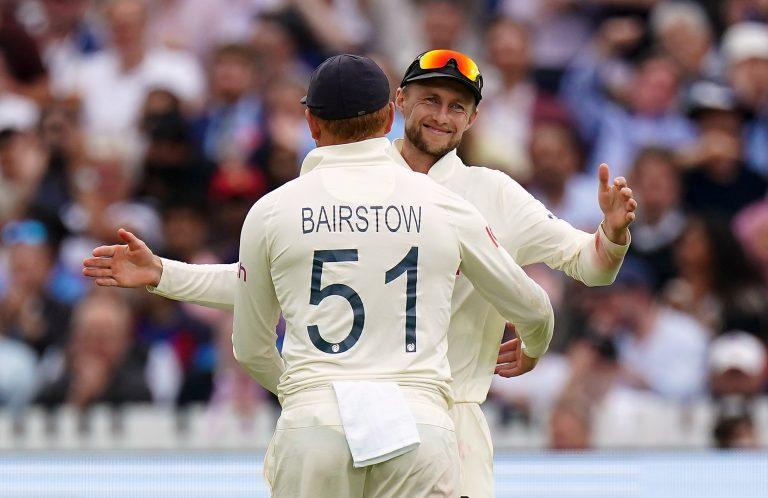 England's Jonny Bairstow, left, celebrates with team-mate Joe Root