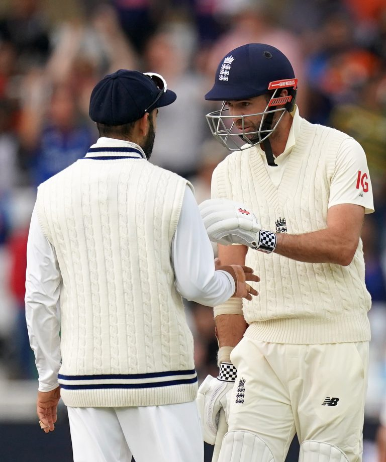 England's Jimmy Anderson, right, exchanges words with India's Virat Kohli