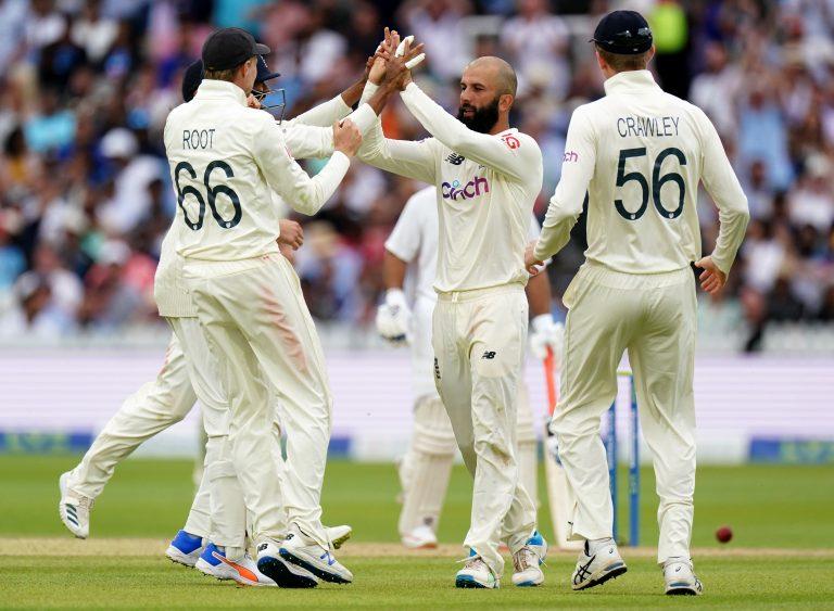 Moeen Ali (centre) celebrates a wicket