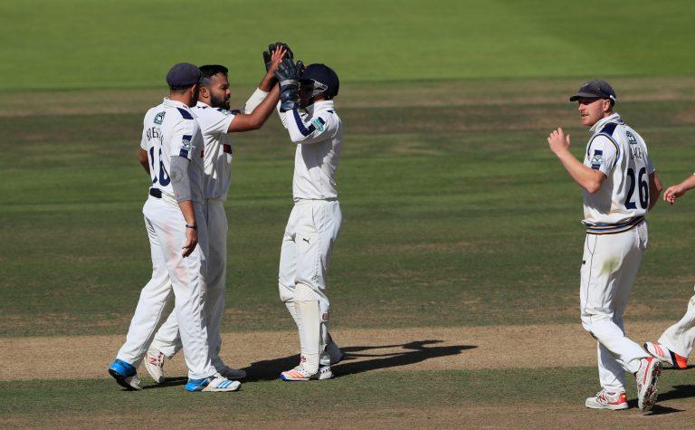 Azeem Rafiq, second left, celebrates a wicket
