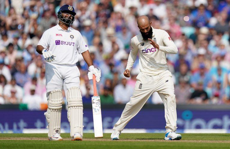 England's Moeen Ali celebrates taking the wicket of India's Virat Kohli