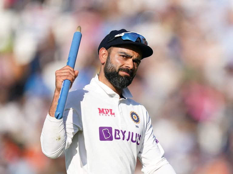 Virat Kohli celebrates after India's fourth Test victory over England at the Kia Oval