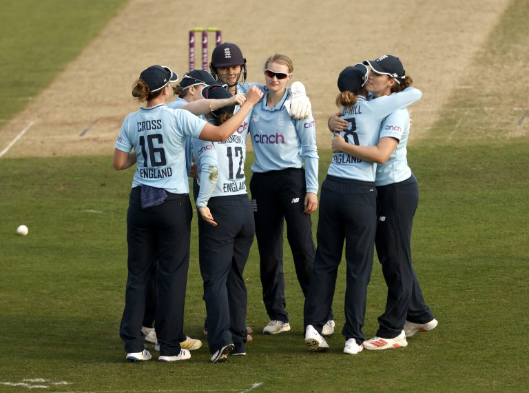 England's Charlie Dean and Tammy Beaumont celebrate with their team-mates